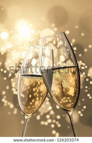 An image of two Champagne glasses on light bokeh background - stock photo