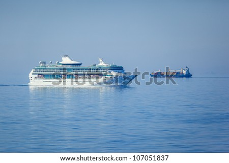 An image of two ships in the blue sea