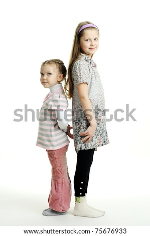An image of two sisters standing next to each other - stock photo