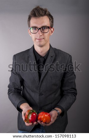 an image of vegetarian vegetable businessman holds in hands