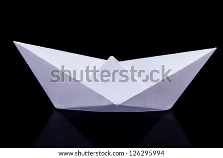 An image of white origami boat - stock photo