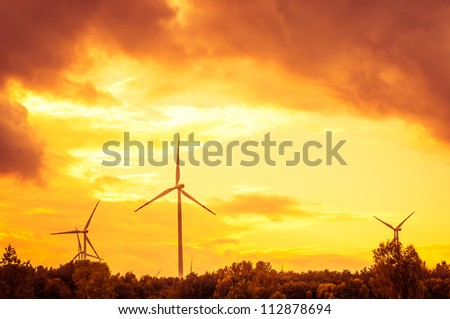 An image of windturbine during beautiful sunset