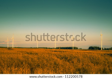 An image of windturbines at dusk - stock photo