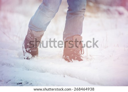 an image of  winter shoes in snow, close-up - stock photo