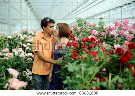 An image of woman and man in a greenhouse