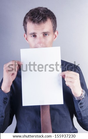 an image of young handsome businessman with blank card