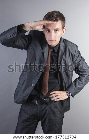 an image of young handsome businessmen look ahead - stock photo
