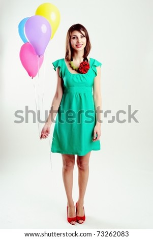 An image of young woman with birthday balloons - stock photo