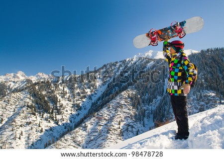 An image with snowboarder with a helmet and glasses on the background of high snow-capped Alps in Grindelwald, Swiss - stock photo