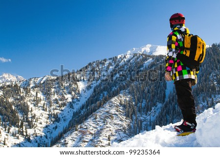 An image with snowboarder with a helmet and glasses on the background of high snow-mountain Alps in Grindelwald, Swiss