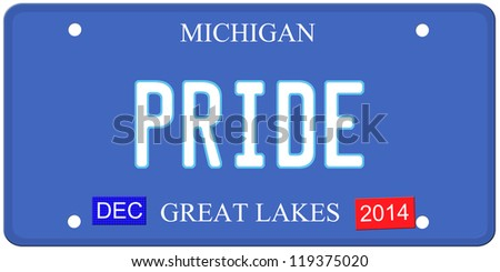 An imitation Michigan license plate with December 2014 stickers and PRIDE written on it making a great Detroit or Michigan auto concept.  Words on the bottom Great Lakes.