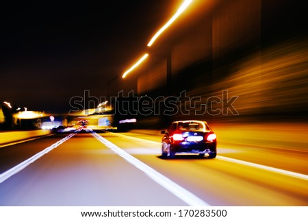 An impression style of pictures of moving traffic on a motor way at night - stock photo