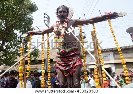An Indian holy man crucified with nail during a local ritual known as Gajan on the last day of Bengali calendar on April 13, 2016 in Hooghly, India.