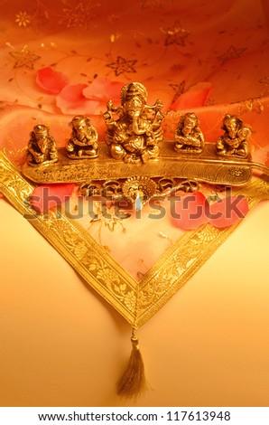 An Indian lamp with Ganesha Idol. - stock photo