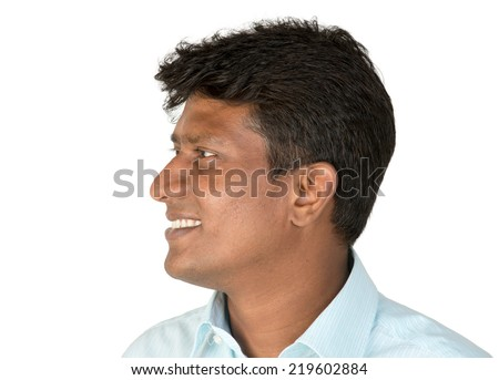 An Indian / South Asian business executive in a light blue shirt looking away / side profile. Isolated on white background.