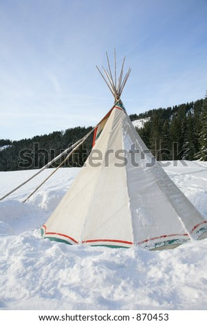 An indian tent in a snow place. (Some noise).