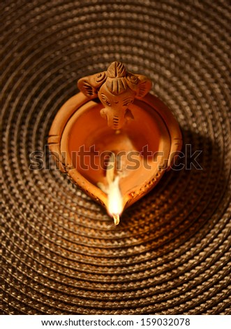 An Indian traditional oil lamp - stock photo