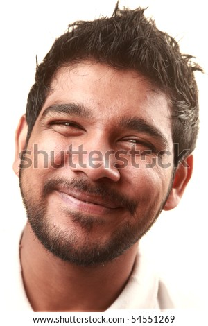 An Indian young man giving a  humorous smile - stock photo