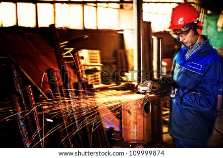 An industrial background. Welder in a factory - stock photo