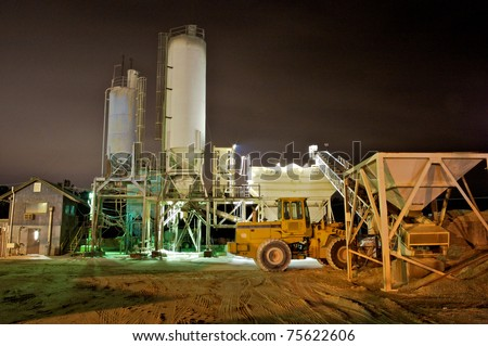 An industrial cement mixing plant at night. Mandeville, Louisiana, United States. - stock photo