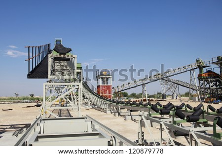 An industrial diamond mining plant is under construction with a lot of unfinished work. - stock photo
