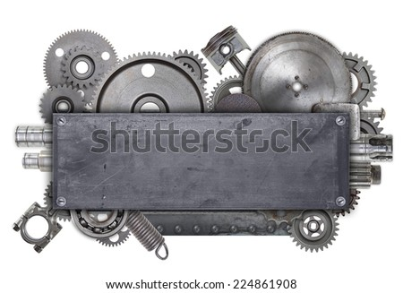 An industrial metal collage made up of old gears and random bits of metal. There is plenty of room for copy on the center metal plate.