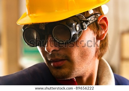 An industrial worker in protective suit - stock photo