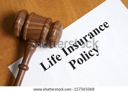 An insurance policy is an asset for anyone taking care of their loved ones once the final day comes. - stock photo