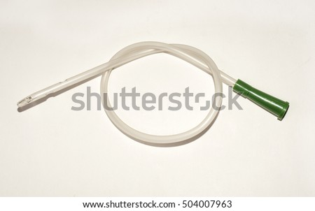 an intermittent transparent catheter isolated over a white background
