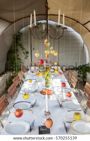 An inventive and fun table setting with different kinds of hanging apples. & Inventive Fun Table Setting Different Kinds Stock Photo (100% Legal ...