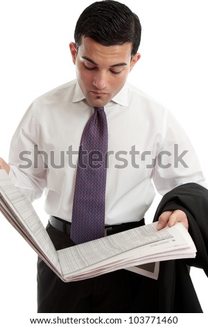 An investor, stockbroker or businessman reads the sharemarket pages of the financial newspaper - stock photo