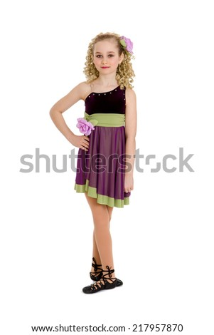An Irish or Celtic Dancer Girl in Recital Costume, Ghillies and Curly Wig - stock photo
