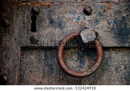 An iron door is getting rusty. - stock photo