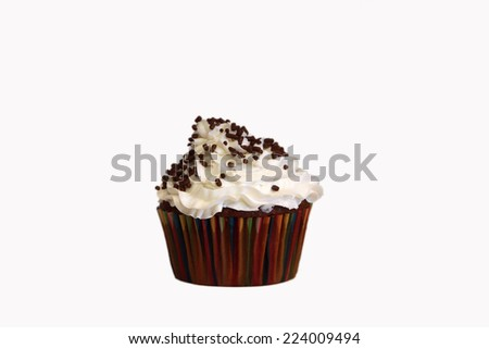 An isolated chocolate cupcake with vanilla frosting on a white background and chocolate sprinkles. - stock photo