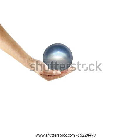 An isolated cutout of a female hand holding a translucent crystal orb.