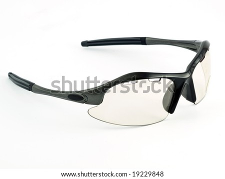 an isolated image of cycling glasses with gray lenses