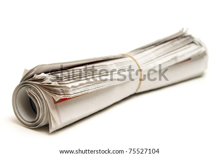 An isolated newspaper that has been rolled and banded. - stock photo
