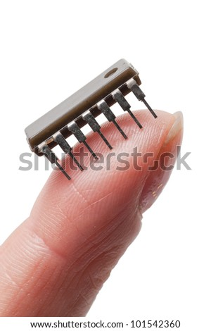 An isolated on hand on a white background holding a micro chip on the finger tip - stock photo