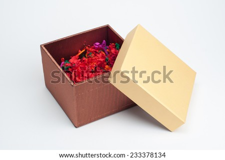 An isolated opened gift box filled with decorative colorful shredded paper. Image on white background. - stock photo