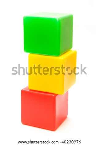 An isolated pyramid from children's color cubes on white background