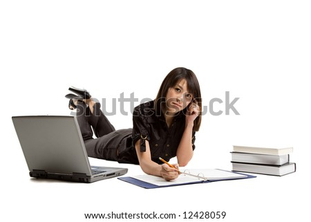 An isolated shot of a beautiful asian student studying with books and laptop - stock photo