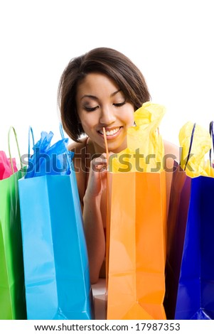 An isolated shot of a beautiful black woman looking at her shopping bags