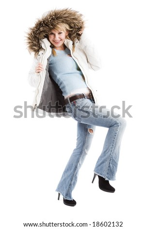 An isolated shot of a beautiful caucasian girl wearing winter jacket