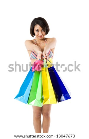 An isolated shot of a black woman in bikini carrying shopping bags