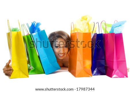 An isolated shot of a black woman with shopping bags - stock photo