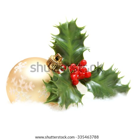 An isolated shot of a Christmas bauble and some holly decor. - stock photo