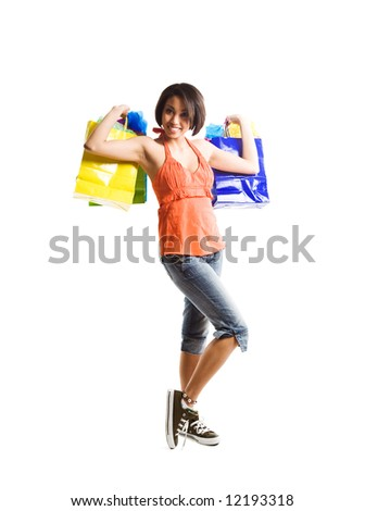 An isolated shot of a happy african american woman shopping