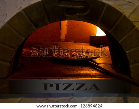 an italian Pizza baking in the oven - stock photo