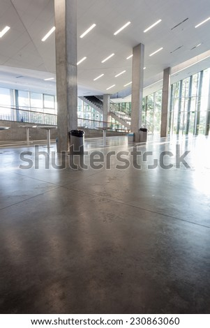 an long corridor in large building with cascading passeth - stock photo