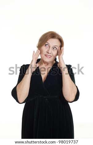 an nice elderly woman in a dress standing on white background